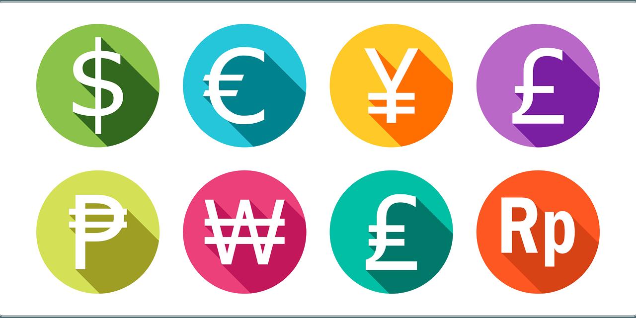 Symbole für Pfund Euro, Yen und US-Dollar